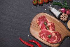 Raw beef on a cutting board  with spices and ingredients for coo. King Stock Image