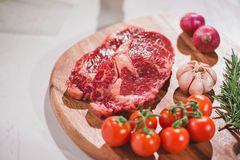 Raw beef on a cutting board  with spices and ingredients for coo. King Stock Photos