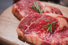 Raw beef on a cutting board  with spices and ingredients for coo. King Stock Images
