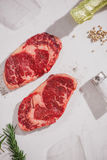 Raw beef on a cutting board  with spices and ingredients for coo. King Stock Photo
