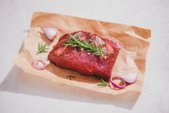 Raw beef on a cutting board  with spices and ingredients for coo. King Royalty Free Stock Photography