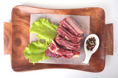 Raw beef edges, lettuce leaf and spices on wooden desk isolated on white background from above and copy space. ready for Royalty Free Stock Photo