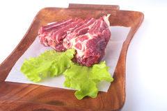 Raw beef edges and lettuce leaf on wooden desk isolated on white background from above and copy space. ready for cooking Stock Photos