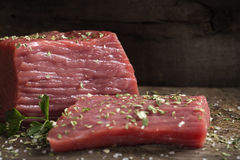 Raw beef fillet with herbs. Meat food - raw beef fillet with parsley on cutting board Stock Photo