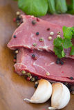 Raw beef fillet with peppers. Verdure and garlic Royalty Free Stock Photography