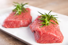 Raw beef fillet with rosemary Royalty Free Stock Photo