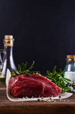 Raw beef fillet. With spices on a wooden background. Selective focus Stock Photo