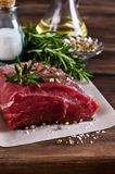 Raw beef fillet. With spices on a wooden background. Selective focus Stock Photography