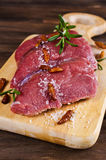 Raw beef fillet. With spices on a wooden background. Selective focus Stock Image