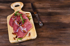 Raw beef fillet. With spices on a wooden background. Selective focus Stock Photos