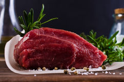 Raw beef fillet. With spices on a wooden background. Selective focus Royalty Free Stock Images