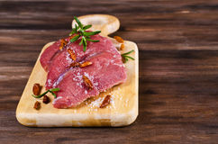 Raw beef fillet. With spices on a wooden background. Selective focus Royalty Free Stock Image