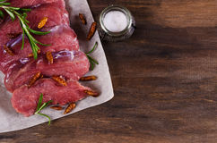 Raw beef fillet. With spices on a wooden background. Selective focus Royalty Free Stock Photography