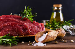 Raw beef fillet. With spices on a wooden background. Selective focus Royalty Free Stock Photos