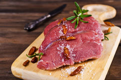 Raw beef fillet. With spices on a wooden background. Selective focus Stock Images
