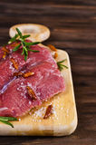 Raw beef fillet. With spices on a wooden background. Selective focus Royalty Free Stock Photo