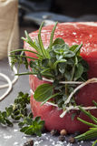 Raw Beef Fillet Steak with herbs Stock Photo