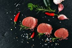 Raw beef fillet steaks mignon on dark background.  Stock Photography
