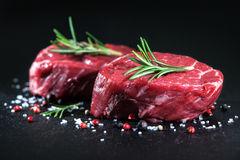 Raw beef fillet steaks with spices Stock Images