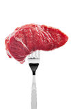 Raw beef on fork Royalty Free Stock Image