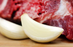 Raw beef with garlic Stock Images