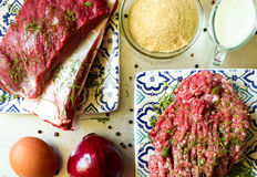Raw beef and ground beef. With ingredients for cutlets Royalty Free Stock Photos