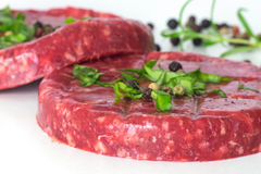 Raw beef hambuger isolated on white Royalty Free Stock Images