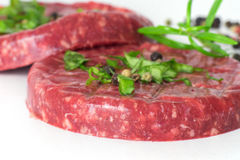 Raw beef hambuger isolated on white Stock Photography
