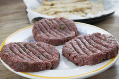 Raw beef hamburger. With aromatic herbs Royalty Free Stock Photos