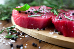 Raw beef with herbs royalty free stock images