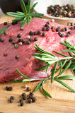 Raw beef with herbs and spices at the kitchen Stock Photo