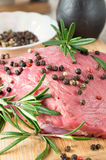 Raw beef with herbs and spices at the kitchen Royalty Free Stock Photo