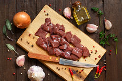 Raw beef liver with spices, herbs  and vegetables Royalty Free Stock Photography