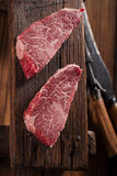 Raw beef marbled steak with vintage background Stock Photo