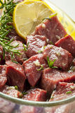 Raw Beef Marinating with Lemon, Oil and Herbs royalty free stock images