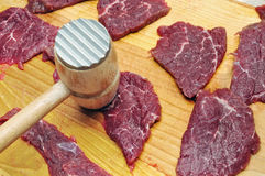 Raw beef meat. On a wooden board Stock Image