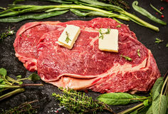 Raw beef meat with butter and fresh herbs, close up Stock Photo