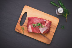 Raw beef meat on a cutting board.  Royalty Free Stock Photos