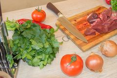 Raw beef meat on a cutting board. Preparing meal, meat and vegetables Stock Photo