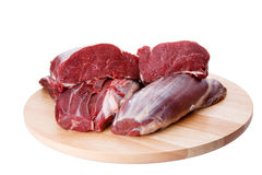 Raw beef meat and cutting board Royalty Free Stock Photography