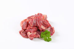 Raw beef meat. Diced raw beef meat on white background Stock Photos