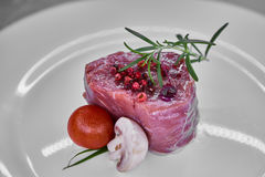 Raw beef meat fillet with peppercorn and thyme ready to grill. Shallow dof Royalty Free Stock Images