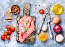 Raw beef meat. Raw beef fillet steaks with spices.Raw meat Royalty Free Stock Photography