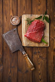Raw beef meat fillet. On wooden  table with meat cleaver and 1lb iron weight Royalty Free Stock Photo