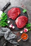 Raw beef meat. Fresh beef steaks. On board Royalty Free Stock Image