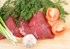 Raw beef meat with fresh vegetables Stock Photos