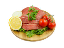 Raw beef meat with fresh vegetables on board Royalty Free Stock Images