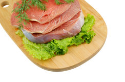 Raw beef meat with fresh vegetables on board Stock Images