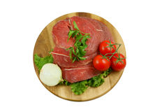 Raw beef meat with fresh vegetables on board Stock Photography