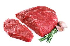 Raw beef meat, garlic and rosemary isolated on white background. With clipping path royalty free stock photo